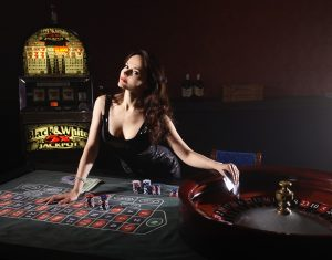 Woman playing real casino games 300x235 - 8 Things about Online Casinos to Explain How They Became So Popular
